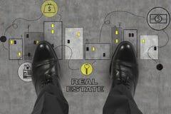 Real estate symbl. Leg realtor standing on real estate symbol Royalty Free Stock Photos