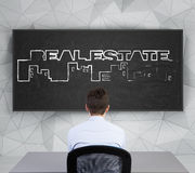 Real estate symbol on chalk board Royalty Free Stock Images