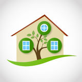 Real estate symbol of ecological house with tree and leaves. As windows. vector conceptual illustration Stock Images