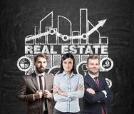 Real estate team, blackboard Stock Photo