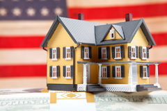 Real estate on usa flag. Real estate and money (Usa dolar) on usa flag Stock Photo