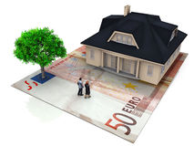 Real Estate value. The value of real estate. A house sitting on top of 50 euros Royalty Free Stock Photo