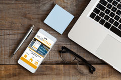 Real estate website in a mobile phone. Business concept. Stock Photo