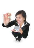 Real Estate Woman. A real estate woman holding a key and house Royalty Free Stock Photo