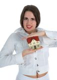 Real estate woman. A woman holding a small house in her hands - real estate concept Royalty Free Stock Photo