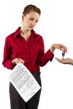 Real Estate. Woman holding keys and a deed of sale contract Stock Photography