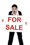 Real estate woman holding for sale sign Stock Photography