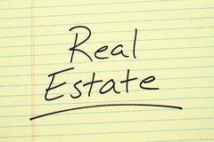 Real Estate On A Yellow Legal Pad. The word `Real Estate` underlined on a yellow legal pad Stock Photography