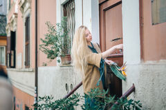 Real estate young woman city building door customer Royalty Free Stock Photography