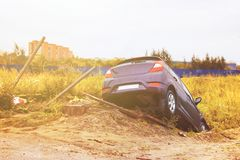 A real event. Car accident. The car drove off the road and toppled over. Car accident during the rain in the autumn time. royalty free stock images