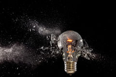 Bulb glass explosion stock image