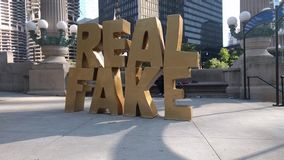 Real Fake art installation at Chicago`s Riverwalk. RIVERWALK, CHICAGO, USA-July 9, 2017. `Real Fake.` Art installation by Scott Reeder located at Wacker Dr and stock video footage