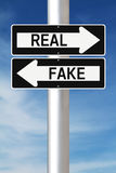 Real or Fake. Modified one way signs indicating Real and Fake Stock Photos