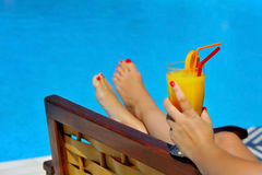 Real female beauty drinking cocktail at swimming pool Royalty Free Stock Images