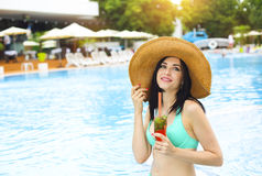 Real female beauty enjoying her summer vacation at swimming pool Royalty Free Stock Photography