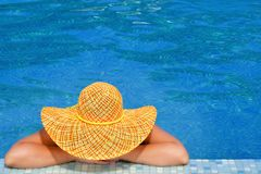 Real female beauty relaxing in swimming pool stock images