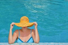 Real female beauty relaxing in swimming pool stock image