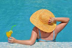 Real female beauty relaxing in swimming pool stock photos