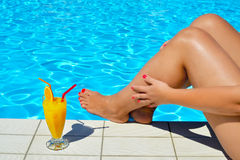 Real female beauty relaxing at swimming pool stock photos