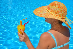 Real female beauty relaxing at swimming pool Royalty Free Stock Photo