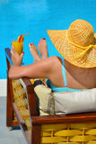 Real female beauty relaxing at swimming pool Royalty Free Stock Photography