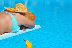 Real female beauty relaxing at swimming pool Royalty Free Stock Photos