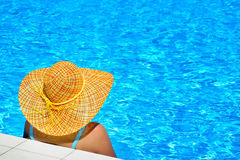 Real female beauty relaxing at swimming pool Royalty Free Stock Images