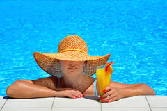 Real female beauty relaxing at swimming pool Stock Photo