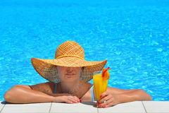 Real female beauty relaxing at swimming pool Royalty Free Stock Image