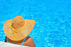 Real female beauty relaxing at swimming pool Stock Image