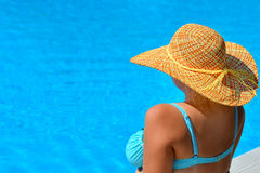 Real female beauty relaxing at swimming pool Stock Images