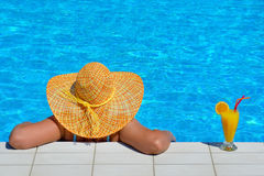 Real female beauty relaxing at swimming pool Stock Photography