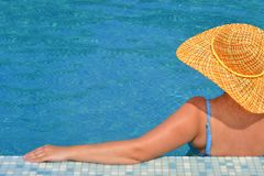 Real female beauty relaxing in swimming pool Royalty Free Stock Photography