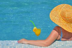 Real female beauty relaxing in swimming pool royalty free stock image