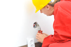 Real female electrician fixing electricity problem. Real female electrician fixing socket electricity problem Royalty Free Stock Photos