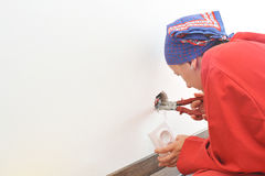 Real female electrician fixing electricity problem Stock Images