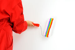 Real female painter painting wall Stock Photo