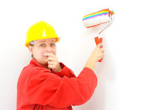 Real female painter painting wall Royalty Free Stock Images