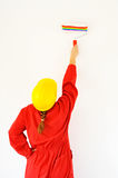 Real female painter painting wall Stock Image