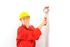 Real female painter painting wall Royalty Free Stock Photo