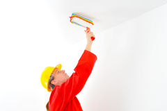 Real female painter renovating her apartment Royalty Free Stock Images