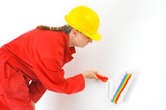 Real female painter renovating her apartment Stock Photography