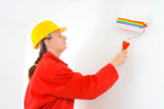 Real female painter renovating her apartment Royalty Free Stock Image