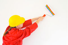Real female painter renovating her apartment Royalty Free Stock Photos