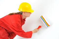 Real female painting wall Royalty Free Stock Photography