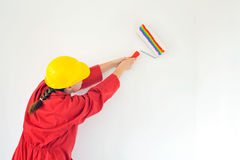 Real female painting wall Royalty Free Stock Images