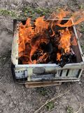 Real fire in the old computer case. Camp, camping, coal, company, delicious, dirt, dust, food, grass, green, grid, grill, healthy, logs, meal, nature, outdoors stock images
