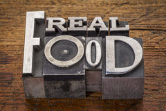 Real food text in metal type Stock Image