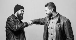Real friendship mature friends. Male friendship concept. Brutal bearded men wear leather jackets. Real men and. Brotherhood. Friends glad see each other stock photo