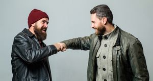 Real friendship mature friends. Male friendship concept. Brutal bearded men wear leather jackets. Real men and. Brotherhood. Friends glad see each other stock images